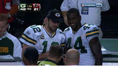 Aaron Rodgers poses for pictures during playoff win, so what?