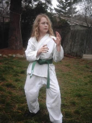Baylin Stich levels up to green belt in karate.