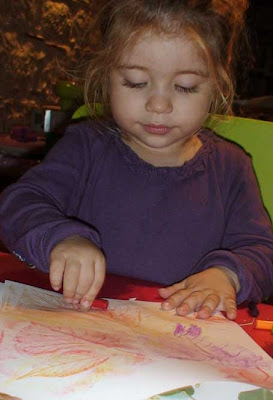 toddler crafts rolling crayons on leaves for fall wreath