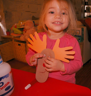 toddler craft gluing Rudolph's eyes