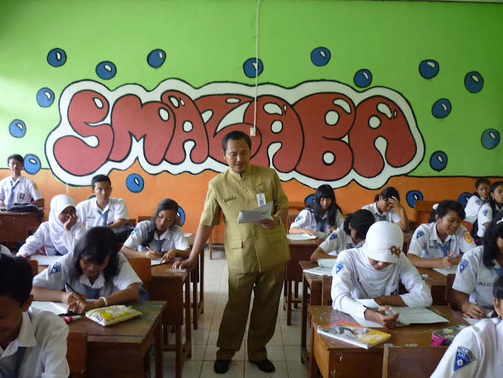 MR. H.M. NURHADI, MM  IS TEACHING IN THE CLASS