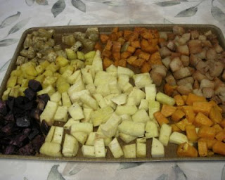 And now roasted -- Upper left = Boniato; Upper center = Red Garnet Yam; Upper right = Tropical Yam; Center left = Japanese Yam; Bottom left = Purple Potat; Bottom middle = Ghana Yam; Bottom right = American sweet potato