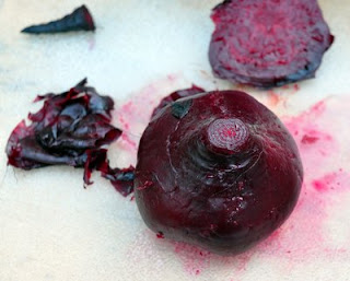 Rub the beet skins with your fingertips.