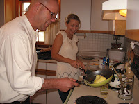 My brother Bob and niece Jessie cooking...Bob is trying to flip the omelet.