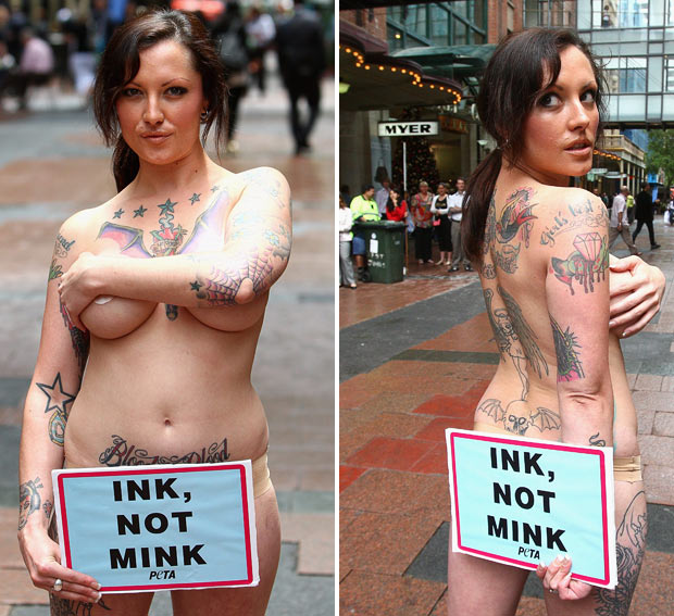 """Tattooed model and PETA supporter Dani Lugosi protests against the wearing"