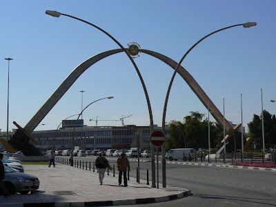 Two giant swords touch to form an arc over Grand Hamad Street.