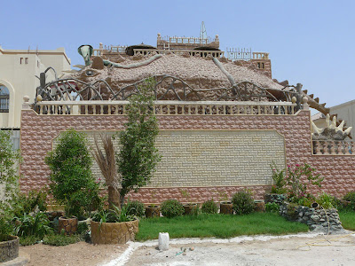 A Qatar Villa - with a dinosaur on top of it!