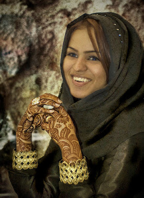 A girl shows off her Henna markings.