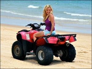 Bridget takes a ride on an ATV on Moreton Island