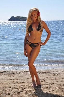 Bridget stands on the beach in Ibiza, Spain