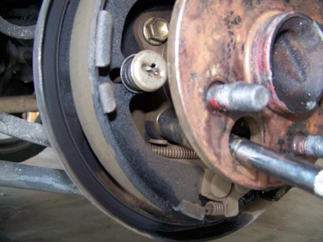 First You Jack Your Car Up And For Safety Place It On A Floor Then Remove The Brake Drum Off Once