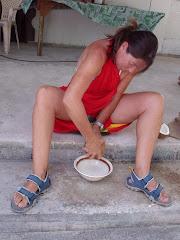 Natalie  OVive grating coconut