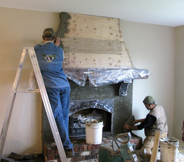 Creating an old world stone fireplace, WITHOUT massive destruction, via http://www.funkyjunkinteriors.net/