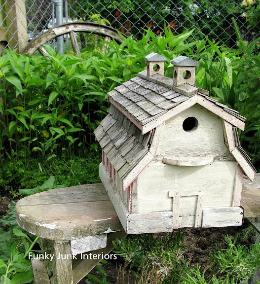 Barn birdhouse on a wooden garden bench funkyjunkinteriors net