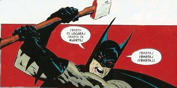 batman poniendo el mal a raya hacha en mano