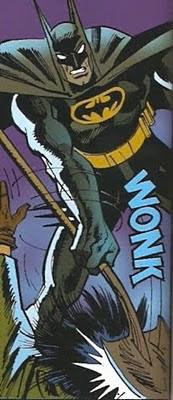 Batman poniendo orden pala en mano
