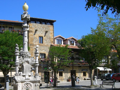 Modernist white fountain in Comillas