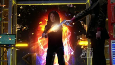 Kristin Kreuk as Lana Lang, snatching bullets out of the air