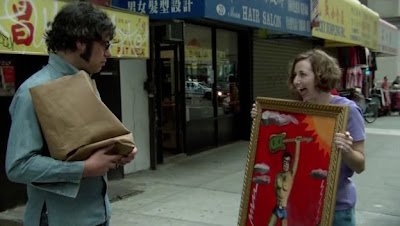 Mel giving Jemaine a painting