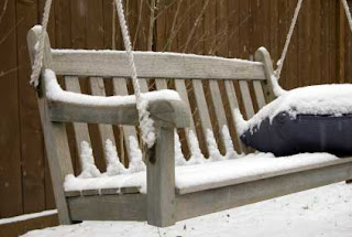 teak bench in snow