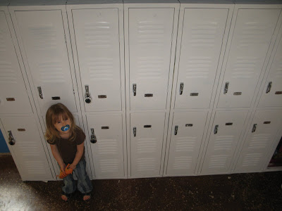 Gloria in front of lockers