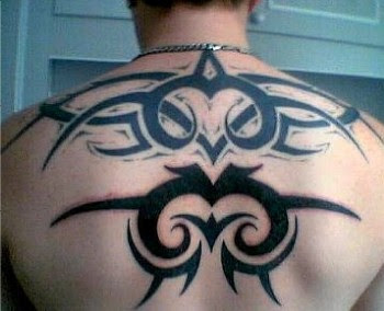 the black in body picture tattoo tribal