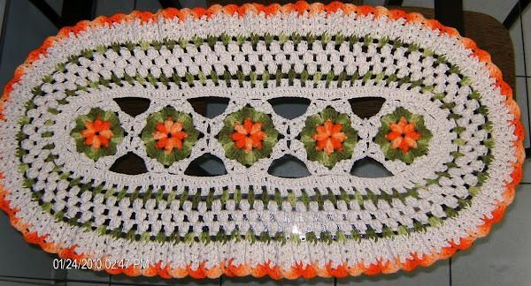 Uma versão maior do Tapete Pipoca na cor alaranjada