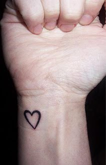 black heart wrist tattoo