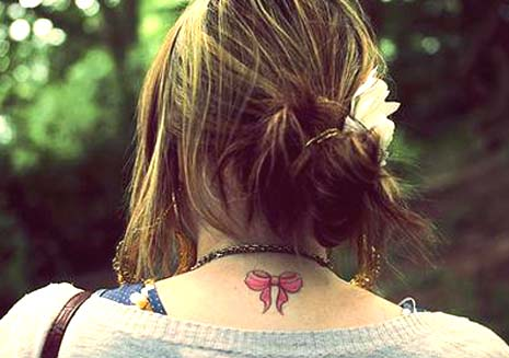 Bow Tattoos. Women have been wearing bows on their hair and clothes as a