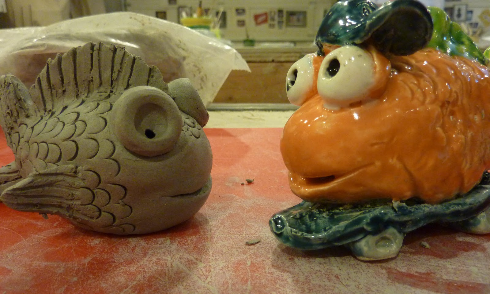 Being cr8iv fish sculptures for Clay pot fish