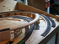 Unpainted wooden train trestle