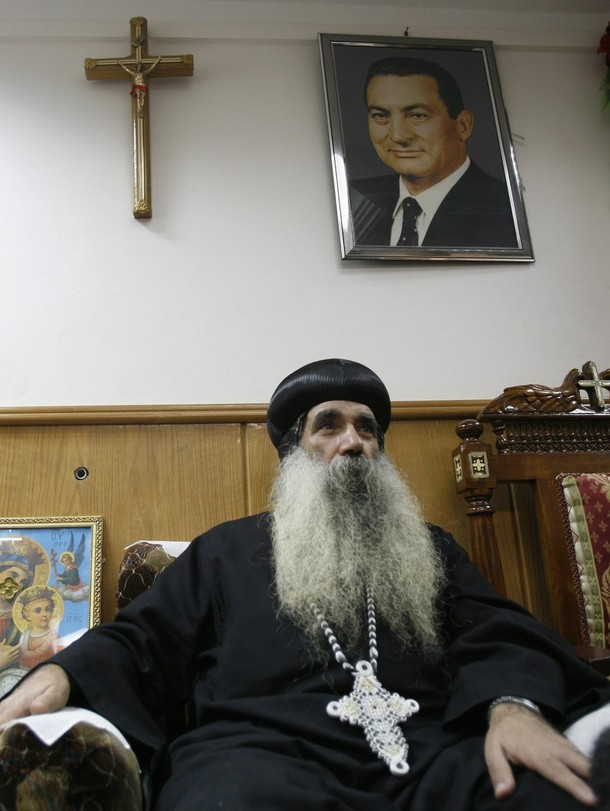 [Anba+Kirolos,+bishop+of+the+Coptic+Christian+church,+talks+to+Reuters+in+his+church+in+Qena,+700+km+(435+miles)+south+of+Cairo,+January+8,+2010.jpg]