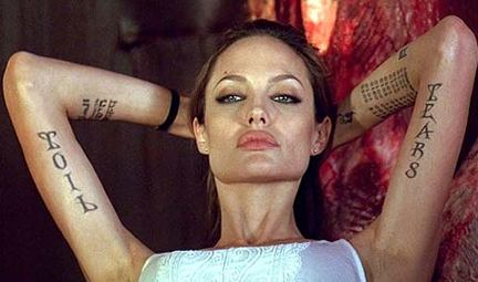 ... two new swirl tattoos to an old roman numeral tattoo on her left arm
