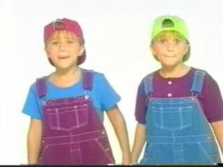 Brightly colored overalls and backwards hats were a typical children s