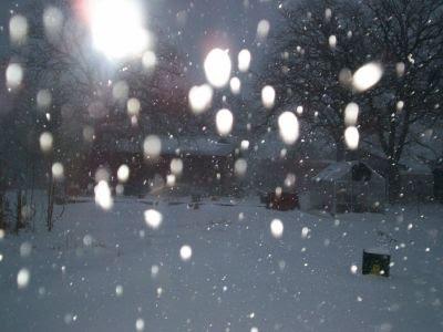 Snow storm behind cabin