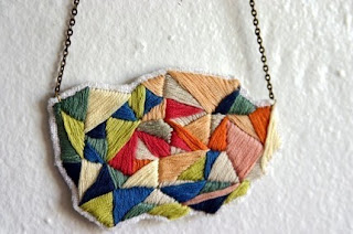 Triangle Explosion necklace by etsy/spinthread