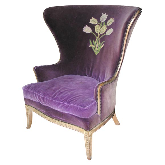 This wing chair is in the style of dorothy draper from the 1940 s