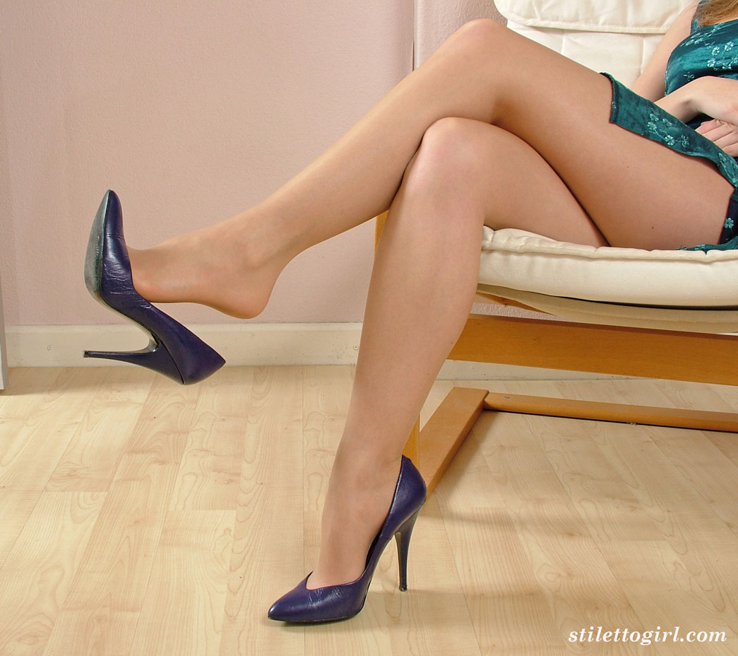sexy legs and heels naughty looking blonde wearing blue high heels and nude pantyhose. Black Bedroom Furniture Sets. Home Design Ideas