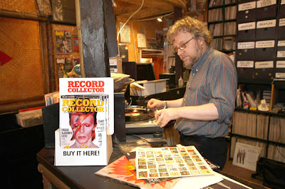 Nick Brown, manager of Intoxica records on Portobello Road, spins some vinyl.