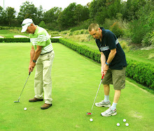 Teaching Stuart the finer points of putting