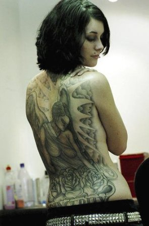 girl tribal back tattoo