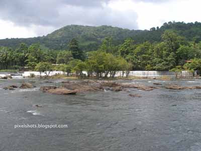 rocky river course of the chalakkudy river of kerala state,fifth longest river of kerala,chalakkudy river,small water cascade in river course