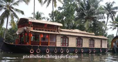 house-boat-kerala,kumarakom-boats,lake-cruises,boat journey,backwater-tours