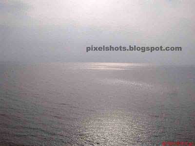 calm sea of kovalam, photo from top of lighthouse, kerala ocean photos, calm arabian sea photos, sea photos from top of lighthouses