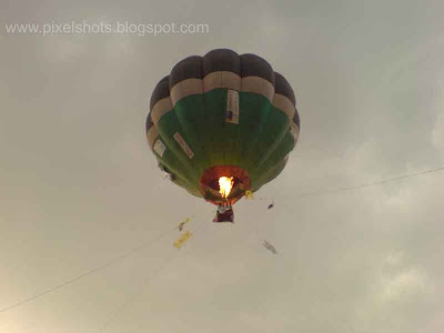 image of hot air balloon flying in the sky from calicut kerala