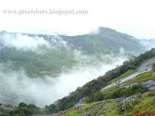 munnar-pictures,munnar-mountains-in-mist,scenic photograph of mist over mountains in munnar hillstation kerala india