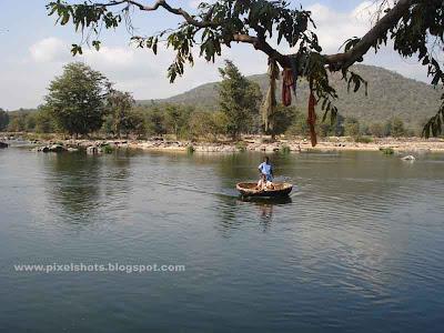scenic photograph of basketboat moving through kauveri river in hogenakkel
