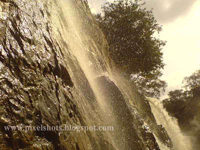 close photograph of the hogenekkal water falls while journey in basket boat
