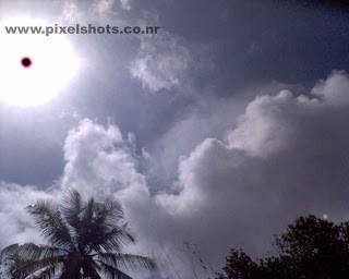 direct photograph of sun and clouds in noon time using mobile phone camera