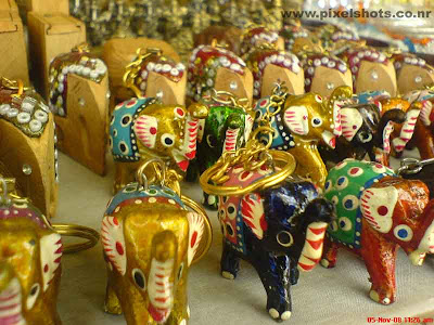 closeup photograph of toys of elephants keychains from street side fancy shop in cochin kerala